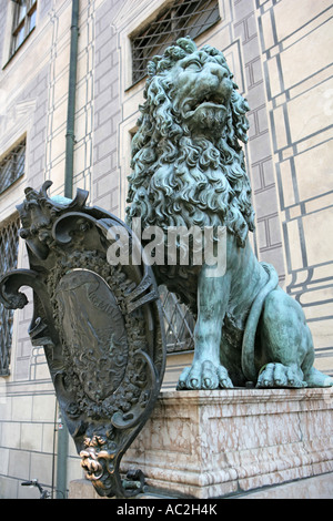Germany Bavaria Germany, Bavaria, Munich a lion sculpture with shield in front of Residenz Palace near Odeonsplatz - Stock Photo