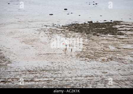 A mother and her young son on the beach at Runswick Bay in North Yorkshire England UK - Stock Photo