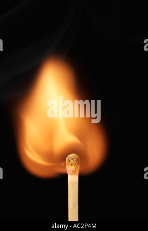 Lit Match with a Flame Flaring Up After Being Struck - Stock Photo
