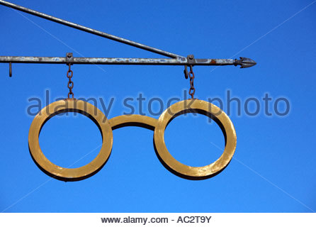 Optometrist sign above shop - Stock Photo