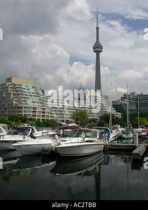 CN tower reflected on harbour water with docked boats in marina Toronto - Stock Photo