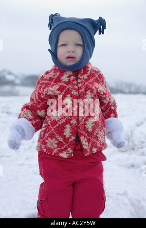 Young boy in the snow - Stock Photo