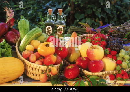 Variety of colorful fruits and vegetables on tabletop in rural France - Stock Photo