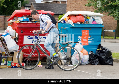 Overflowing waste recycling point in Oxfordshire housing estate 3 - Stock Photo