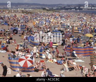 A crowded beach in summer Dawlish Warren near Exeter Devon Great Britain - Stock Photo
