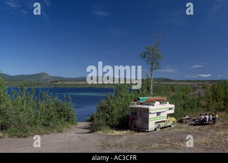 RV Camping in a Wilderness Campground beside a Lake near Atlin, Northern BC, British Columbia, Canada - Stock Photo