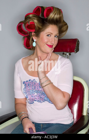 eighties 80's retro humor hair salon image of woman in curlers people white background - Stock Photo