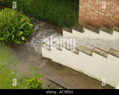 Flood Waters Flowing Down Steps in a Domesitc Garden, Nottingham UK 2007 - Stock Photo