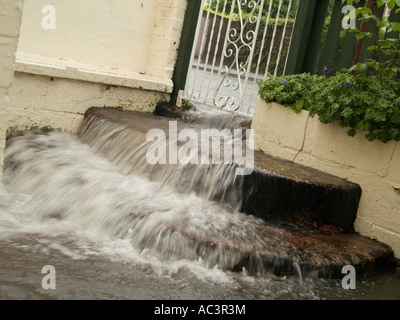Flood Waters Flowing Down Steps in a Domestic Garden, Nottingham UK 2007 - Stock Photo