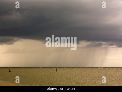 storm approaching picardie coast france green and red lateral marks define a navigable channel. - Stock Photo