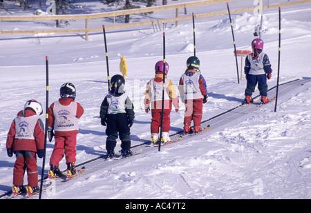 Children Skiers on a moving belt ski lift at Idre Fjäll, Sweden - Stock Photo