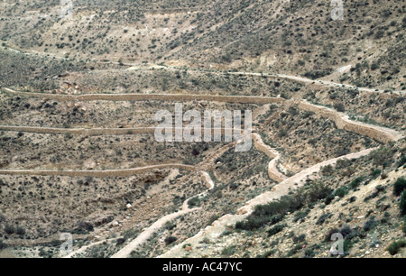 Agricultural terraces on the road to Nefta in Southern Tunisia North Africa near the Algerian border - Stock Photo