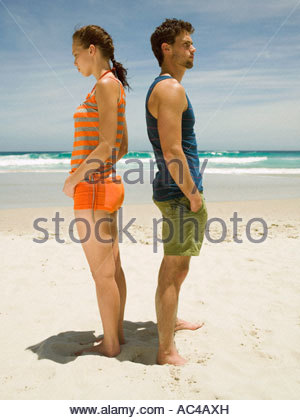 Couple having an argument on the beach - Stock Photo