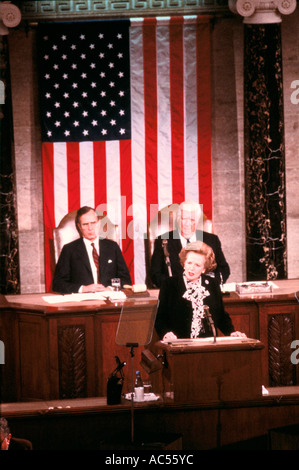 MARGARET THATCHER GIVES A SPEECH IN FRONT OF GEORGE BUSH AND THE AMERICAN FLAG - Stock Photo