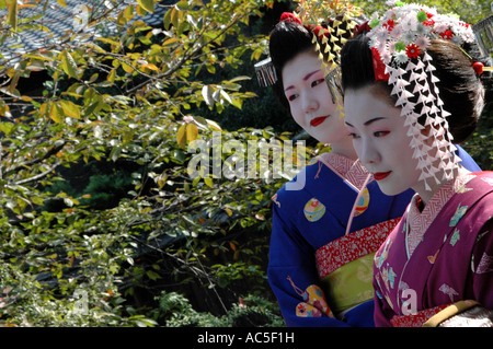 Two maikos trainee geishas in the Gion district in Kyoto, Japan - Stock Photo