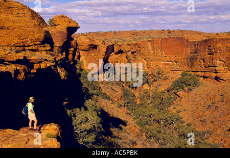 Walker at lookout on north rim of canyon,Watarrka (Kings Canyon) National Park, Northern Territory, Australia, horizontal, - Stock Photo