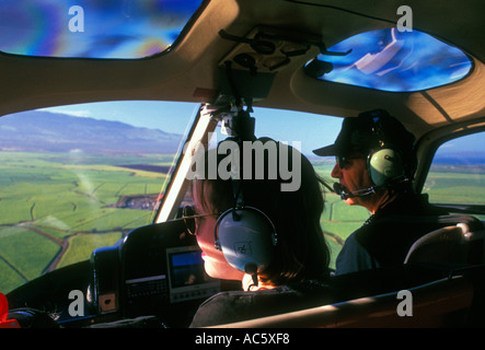 helicopter pilot, passenger, helicopter tour, helicopter ride, Maui, Maui Island, Hawaii, United States - Stock Photo
