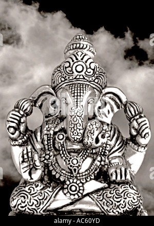 Statue of Lord Ganesh against Cloudy background - Stock Photo