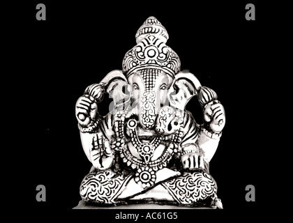 Statue of Lord Ganesh against black background - Stock Photo