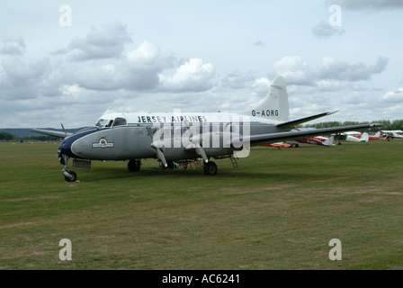 Jersey Airlines Heron Airliner on the Ground at Goodwood Revival Meeting 2003 West Sussex England United Kingdom - Stock Photo