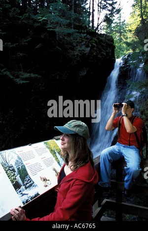 young couple hiking in Fundy National Park New Brunswick Canada - Stock Photo