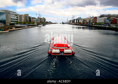 Spirit of Docklandsmotoring west on the river liffey, Dublin Ireland1 - Stock Photo