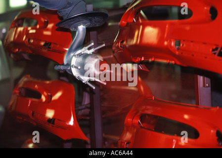 Robot paints car parts assembly plant Germany. HOMER SYKES - Stock Photo