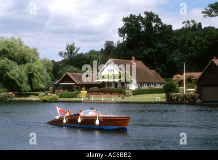 A traditional slipper launch near Hambleden Lock on the River Thames England UK - Stock Photo