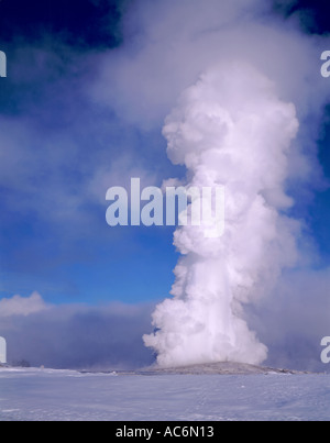 Yellowstone National Park WY Old Faithful Geyser eruption in winter - Stock Photo