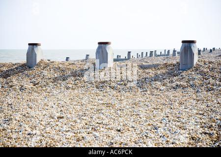 Beach Groins on a pebble beach - Stock Photo
