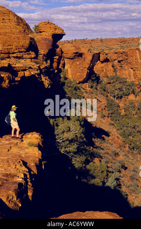 Walker at lookout on north rim of canyon, Watarrka (Kings Canyon) National Park, Northern Territory, Australia, - Stock Photo