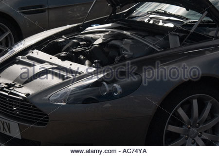 An Aston Martin DB9 sports car parked outside the St Pancras Hotel