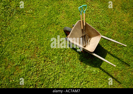 Wheelbarrow on the lawn. - Stock Photo