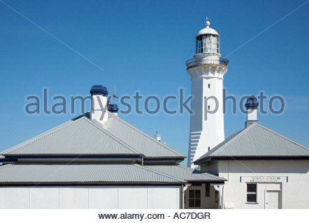 Green Cape Lighthouse with adjacent building in Ben Boyd National Park New South Wales Australia - Stock Photo