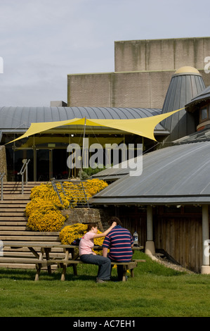 Exterior shot of Aberystwyth Arts centre  Wales UK - two people sitting outside - Stock Photo