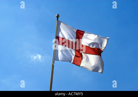 English Flag Flag of St George flying against a blue sky - Stock Photo