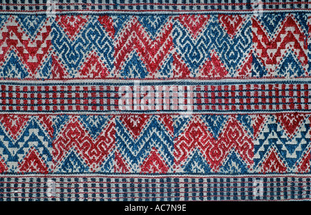 Bhutanese brocaded fabric with supplementary weft brocading Woven on a hip strap loom Bhutan - Stock Photo