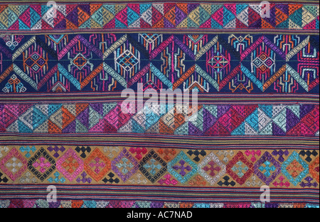 Bhutanese brocaded fabric with silk supplementary weft brocading Woven on a hip strap loom Bhutan - Stock Photo