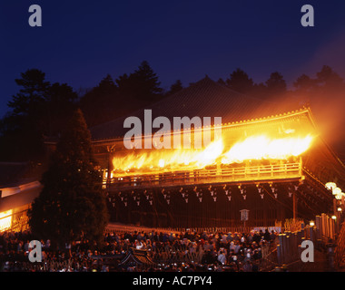 Omizutori (Water-drawing Festival) at Nigatsu-do Temple in Nara City. Buddhist monks carry flaming torches around - Stock Photo