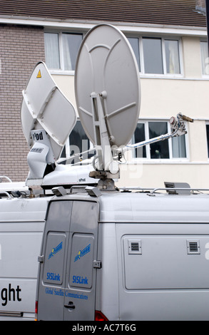 Television satellite trucks at news event in Rhondda Valley South Wales UK - Stock Photo