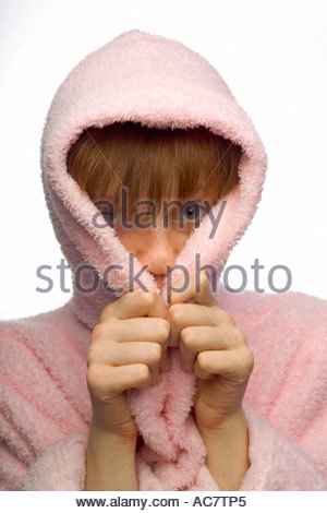 Young girl hiding in her dressing ground hood - Stock Photo