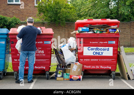 Overflowing waste recycling point in Oxfordshire housing estate 5 - Stock Photo