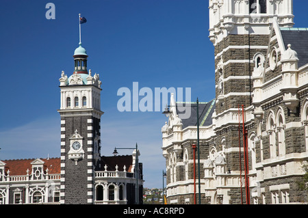Historic Law Courts right and Railway Station left Dunedin South Island New Zealand - Stock Photo