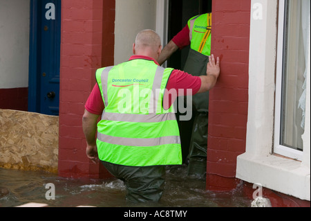 Council workers check upon residents during the unprecedented June 2007 floods in Bentley, Doncaster, Yorkshire, - Stock Photo