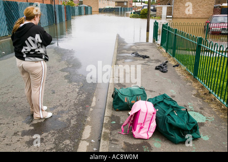 The unprecedented floods in Toll Bar near Doncaster, Yorkshire, UK, a women with salvaged belongings - Stock Photo