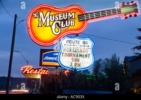 Landmark neon sign of the world famous Museum Club roadhouse along Route 66 in Flagstaff Arizona USA at dusk. - Stock Photo