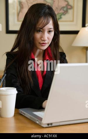 Busineswoman using a laptop - Stock Photo