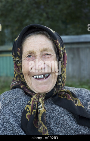 portrait of an old smiling woman, Moldova - Stock Photo