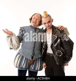 William Shakespeare smiling with arm around gothic punk young man - Stock Photo