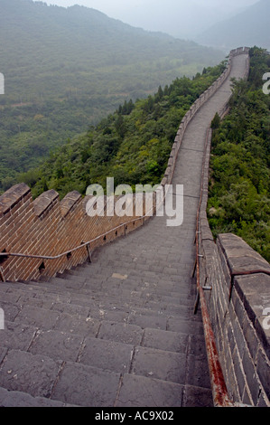 Section of the Great Wall of China At Juyongguan Gate Near Badaling on a misty day - Stock Photo